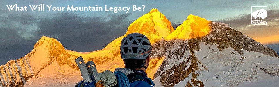 What will your mountain legacy be? man with helmet looking at snow covered peaks in the sunrise