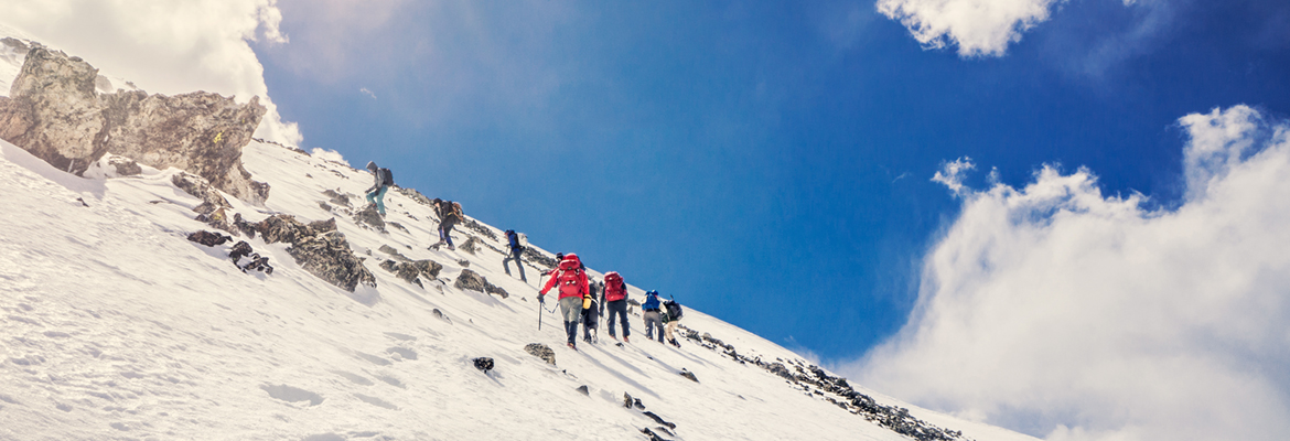High Altitude Mountaineering Students Hike Up the Snow