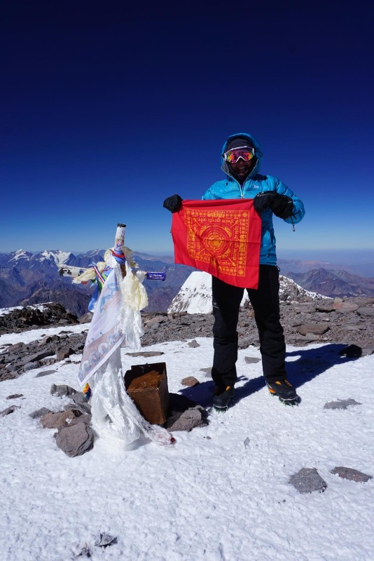 Woman on top of Aconcagua
